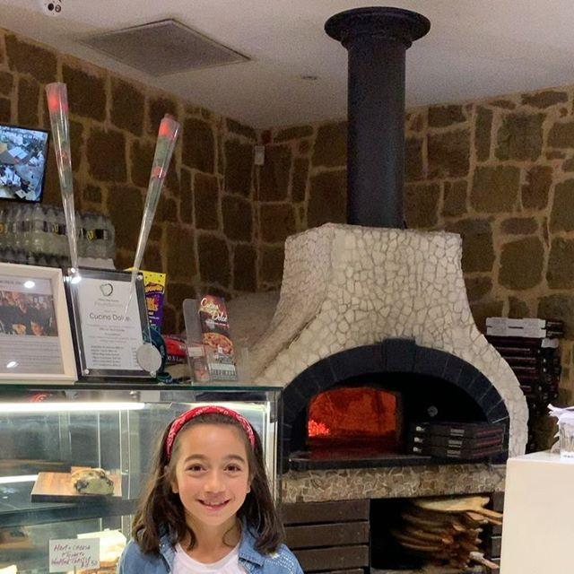 kid at pizzeria